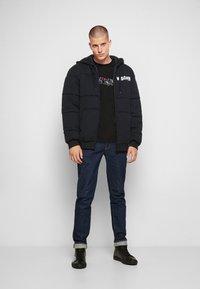MOSCHINO - Winter jacket - black - 4