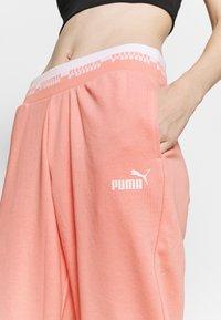 Puma - AMPLIFIED PANTS - Tracksuit bottoms - apricot blush - 4