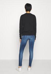 Calvin Klein Jeans - SUPER SKINNY - Jeans Skinny Fit - mid blue - 2