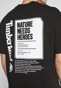 Timberland - STATEMENT PRINT TEE - Print T-shirt - black - 5