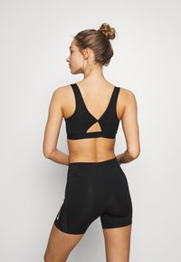 Nike Performance - FAVORITES NOVELTY BRA - Sport BH - black/smoke grey - 2