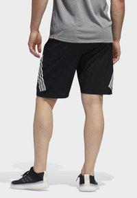 adidas Performance - 4KRFT 3-STRIPES 9-INCH SHORTS - Sports shorts - black - 1