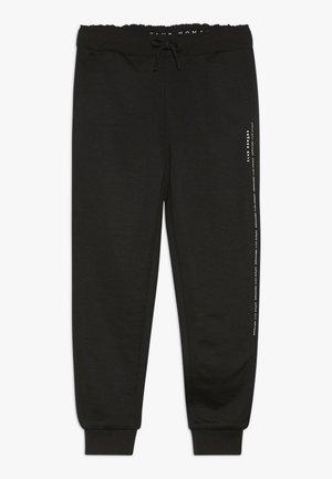 CLUB NOMADE EASY PANT - Pantalones deportivos - black