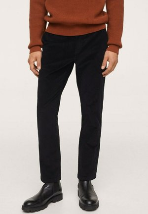 TAPERED FIT  - Trousers - black