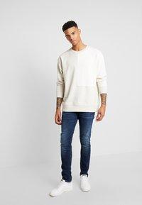 Scotch & Soda - TYE - Jeans Tapered Fit - icon blauw - 1