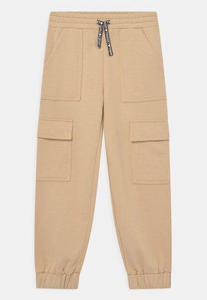 Pantaloni sportivi - marzapane