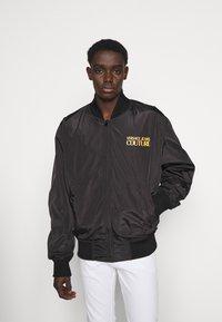Versace Jeans Couture - JACKET - Bomber Jacket - black - 4