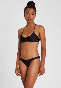 SIMPLY SOLID SKIMPY - Bikini bottoms - black