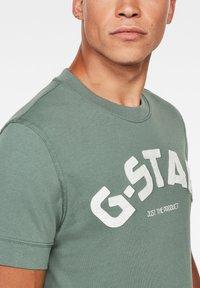 G-Star - FELT APPLIQUE LOGO SLIM R T S\S JUNGLE MEN - T-shirt print - jungle - 3