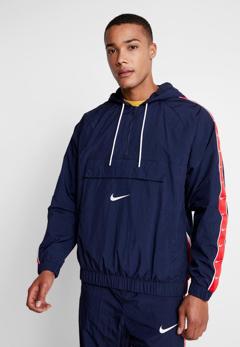 Nike Sportswear - Windbreaker - obsidian/white/university red