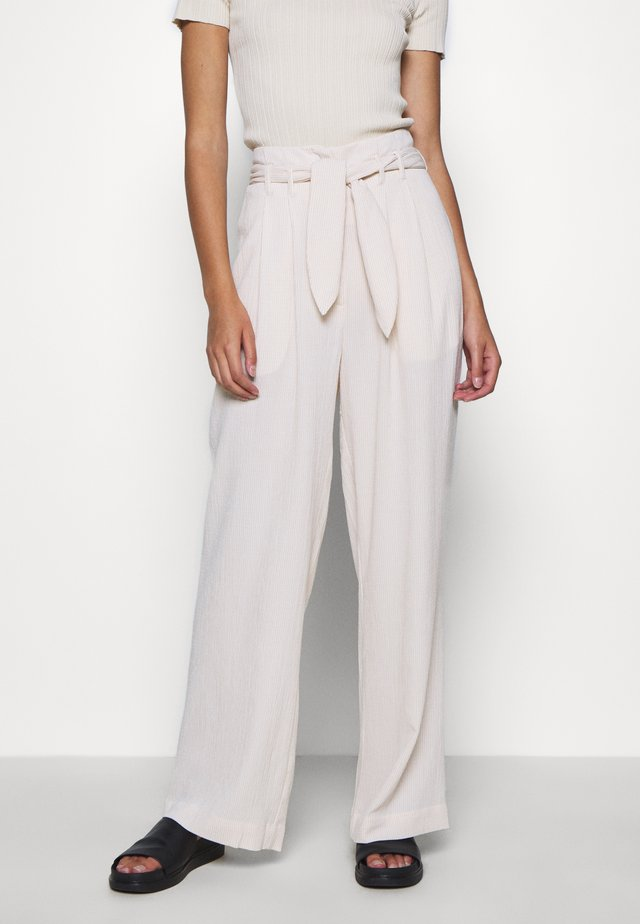 NELLIE TROUSERS - Pantaloni - warm white