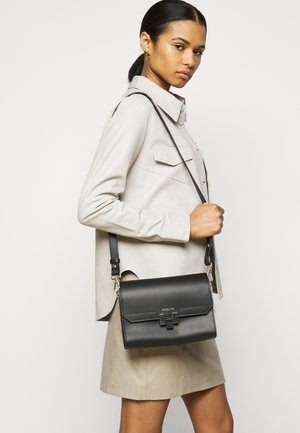 LILIA TABLET MINI - Across body bag - black