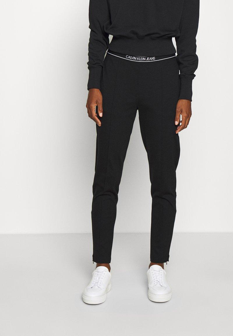 Calvin Klein Jeans - LOGO ELASTIC MILANO TROUSER - Trousers - ck black