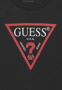 Guess - JUNIOR DRESS CORE - Jersey dress - jet black - 2