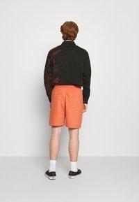 Nike Sportswear - REVIVAL - Shorts - light sienna/dark smoke grey - 2