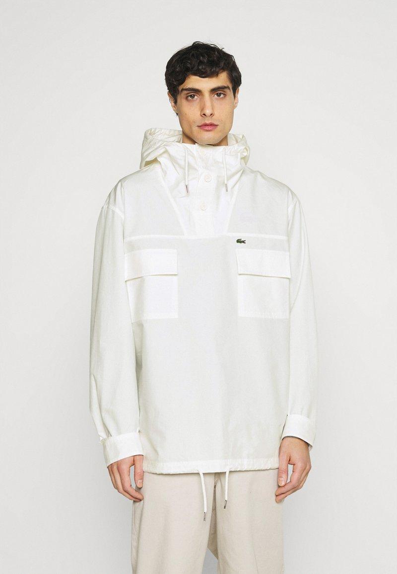 Lacoste - Waterproof jacket - flour