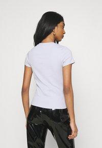 Monki - MAGDALENA TEE 2 PACK - Print T-shirt - black dark solid/lilac - 2