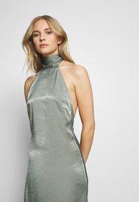 UNIQUE 21 - HALTERNECK OPEN BACK DRESS - Společenské šaty - green - 3