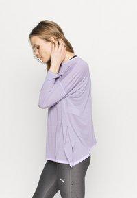 Puma - STUDIO GRAPHENE LONG SLEEVE - Langarmshirt - light lavender - 4