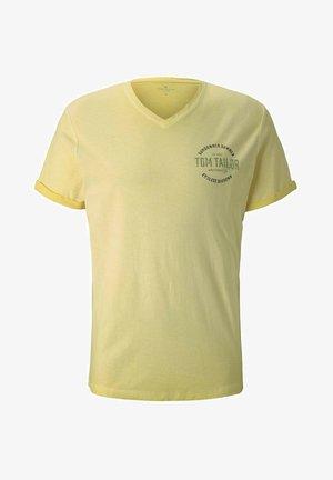 IM USED LOOK  - Print T-shirt - pale straw yellow