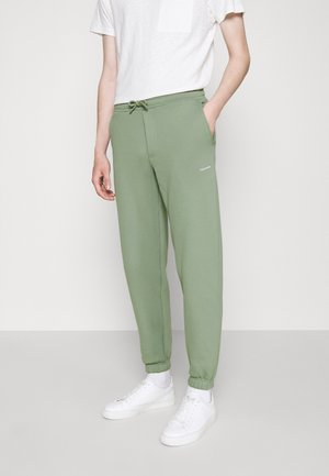 FLEASER TROUSERS  - Tracksuit bottoms - teal