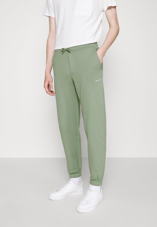 FLEASER TROUSERS  - Pantalon de survêtement - teal