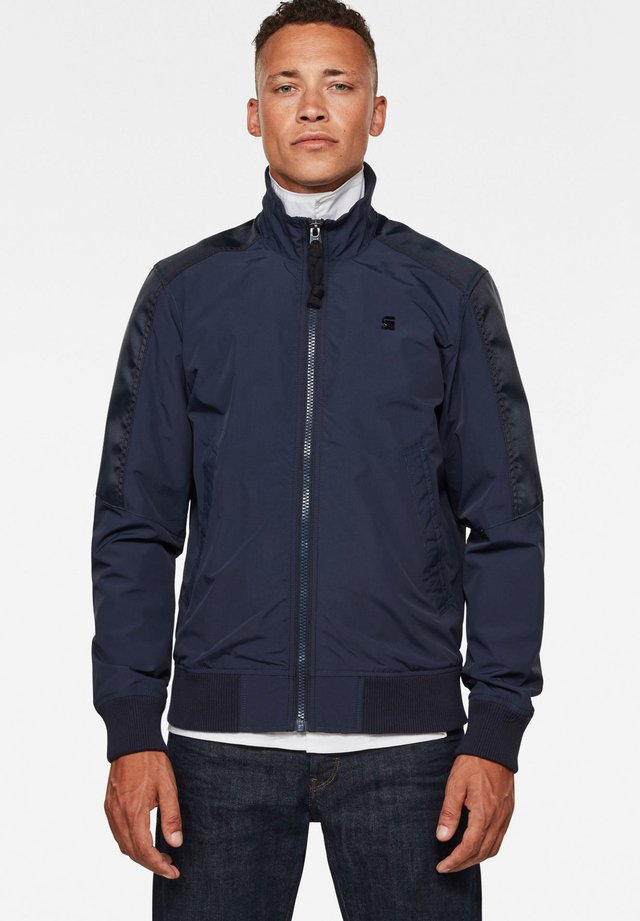 MESON TRACK - Trainingsjacke - sartho blue