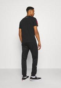 adidas Originals - Träningsbyxor - black - 2