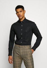 Calvin Klein Tailored - STRETCH SLIM - Formal shirt - black - 0