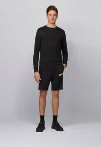 BOSS - HEADLO BATCH Z - Pantalon de survêtement - black - 1