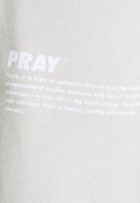 PRAY - HOPE JOGGER UNISEX - Tracksuit bottoms - grey - 2