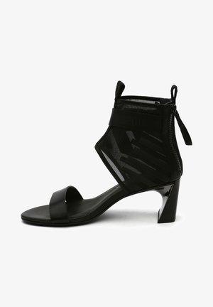 CALLI MID - Ankle cuff sandals - black mesh