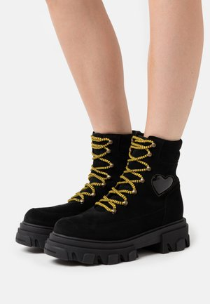 HIKING HEART - Platform ankle boots - black