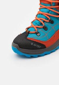 Hi-Tec - CARNIVAL WP JR UNISEX - Hiking shoes - light blue/orange - 5
