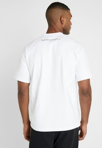 adidas Performance - MUST HAVE ATHLETICS SHORT SLEEVE TEE - Print T-shirt - white/black - 2