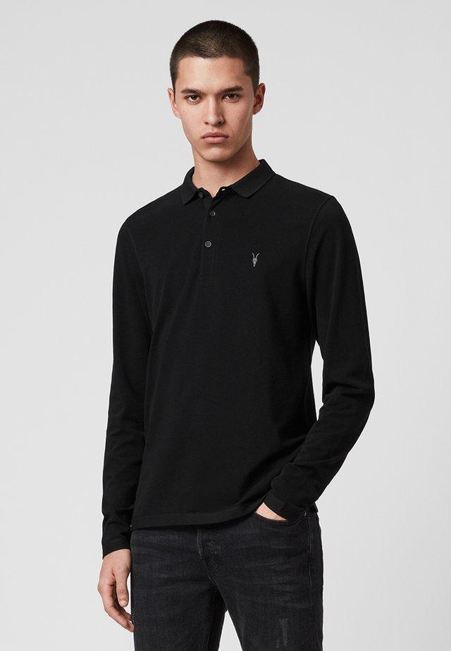 REFORM  - Poloshirt - black