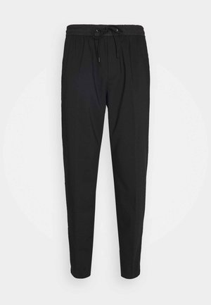 TRAVEL PANT - Tracksuit bottoms - black