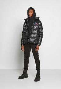 White Mountaineering - MILLET X WM JACKET - Down jacket - black - 1