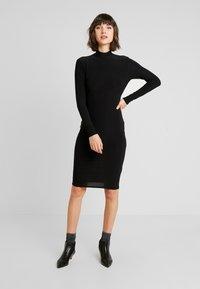Club L London - OPEN BACK RUCHED LONG SLEEVE BODYCON DRESS - Shift dress - black - 2
