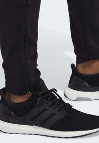 adidas Performance - RUN IT 3-STRIPES ASTRO JOGGERS - Pantalon de survêtement - black - 5