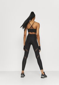 Puma - PAMELA REIF X PUMA MID WAIST LEGGINGS - Leggings - black - 2
