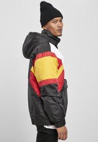 Starter - Outdoor jacket - blk/wht/starter red/golden - 4
