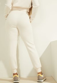 Guess - Tracksuit bottoms - creme - 1