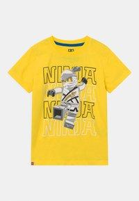LEGO Wear - Print T-shirt - yellow - 0