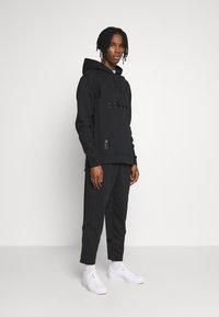 adidas Originals - WARMUP - Pantalon de survêtement - black - 1