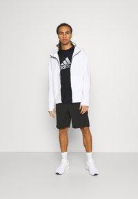 adidas Performance - Print T-shirt - black/gresix - 1