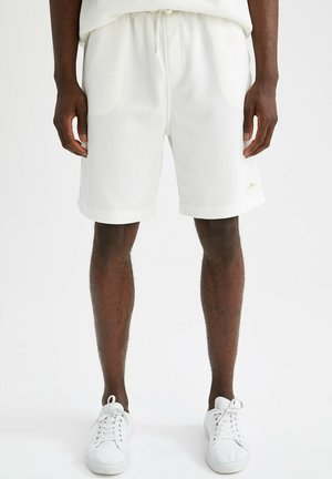RELAX FIT - Tracksuit bottoms - white