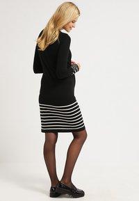 JoJo Maman Bébé - Jumper dress - black/ecru - 2