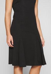 Lost Ink Petite - SLEEVELESS FISHTAIL BODYCON DRESS - Jersey dress - black - 6