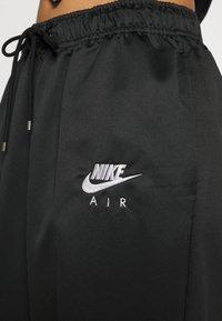 Nike Sportswear - AIR - Tracksuit bottoms - black/white - 6
